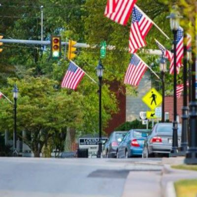 view of a street and hanging flags in downtown